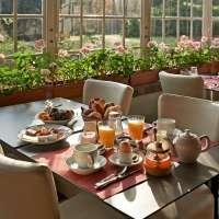 La véranda où sont servis les petits-déjeuners © La Rubanerie